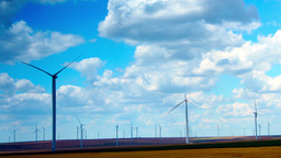 Wind Turbines With Turquoise Sky, Green Energy. Time Lapse, Tilt Footage