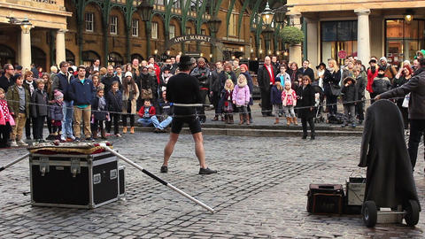 Covent Garden In London - Artist Fettered By Chain stock footage