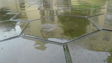Raindrops Fall To Flagstones stock footage