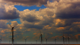 Sunset and Wind Turbines, Time Lapse, Zoom Out Footage
