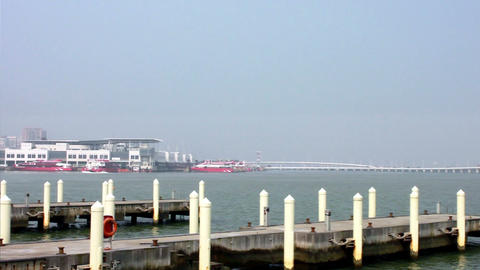 Empty mooring posts at Macau Fisherman's Wharf and view of Outer Harbour Ferry T Footage