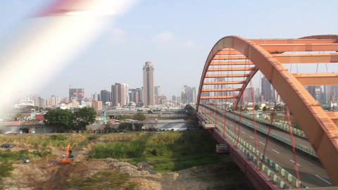 Taiwan Urban Scene Out of The Window of a Driving High-Speed Train. HD Live Action