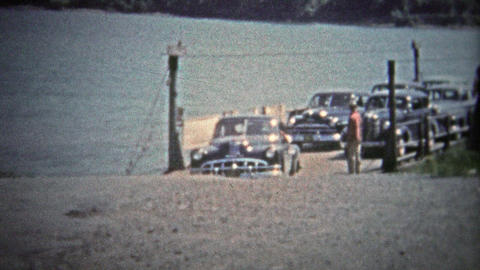 TENNESSEE, USA - 1954: Car ferry unloading at a rural spot along the Tennessee R Footage