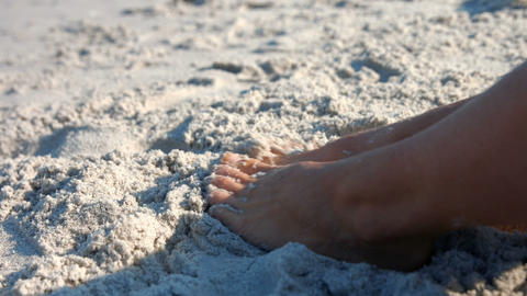 Close up view of woman foot on sand Live Action