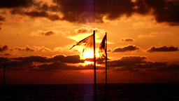 Tattered waving flag in sunset - no-loop-version Footage