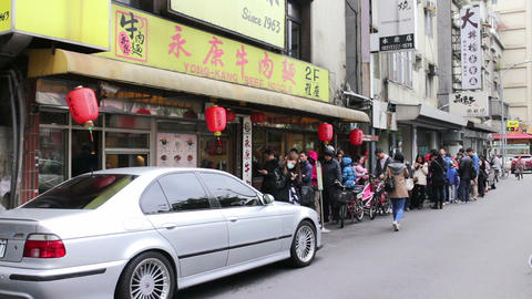 People Queuing Up Outside The Door Of Yongkang Beef Noodles. HD stock footage