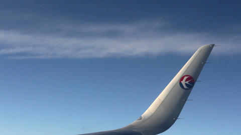 Aerial View with the Wing of China Eastern Airline's Plane. HD Live Action