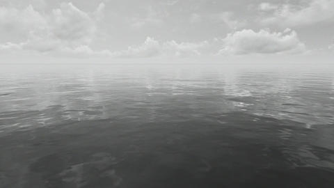 Timelapse clouds over mirror sea surface Footage