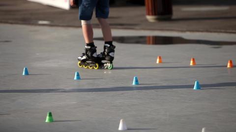 Roller skate slalom between cones closeup Footage