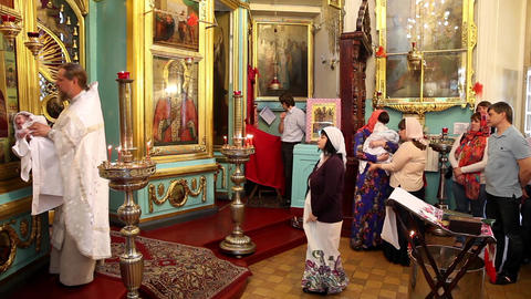 MOSCOW, RUSSIA - JULY 15, 2015: Christening of little baby in orthodox church on Footage