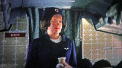 CHICAGO - 1966: Stewardess on an international flight on an airplane bound for E Footage