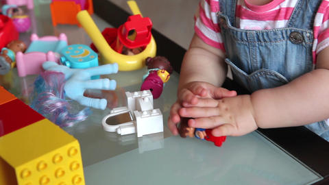 Small kid playing with constructor toy. Only hands in frame Footage