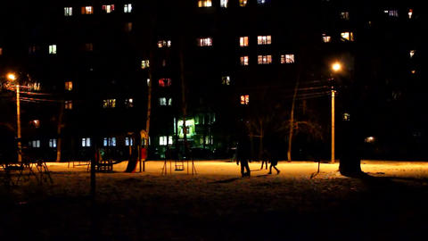 Children In The Dark Playing Soccer In The Winter stock footage