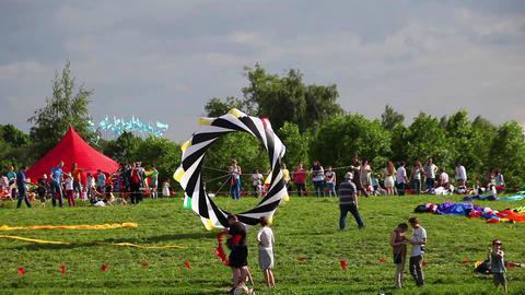 People fly kites on the kite festival in park Tsaritsyno in Moscow, Russia Footage
