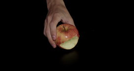 Red Apple With A Bite Taken On Black Background stock footage