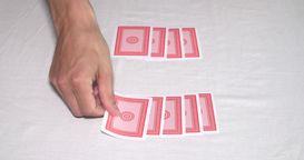 Hands on a poker table shuffling a deck of cards and dealing Footage