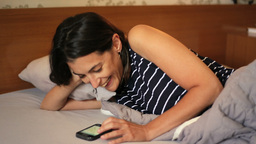 Woman enjoy chat on mobile phone Filmmaterial