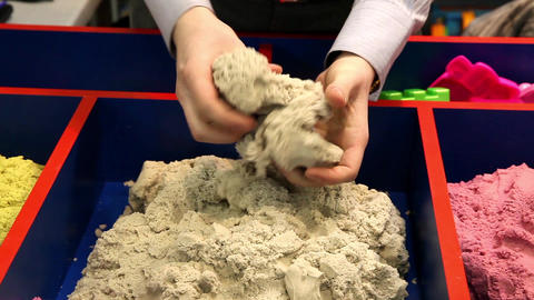Kinetic Sand Experience. Man Demonstrating Kinetic Sand stock footage