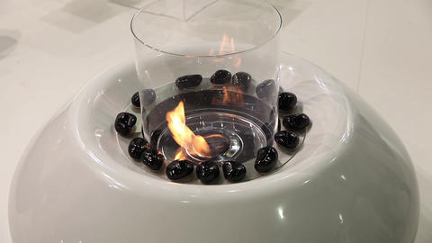Modern artificial fireplace in room interior Stock Video Footage