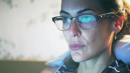Woman with glasses look at a computer screen Footage