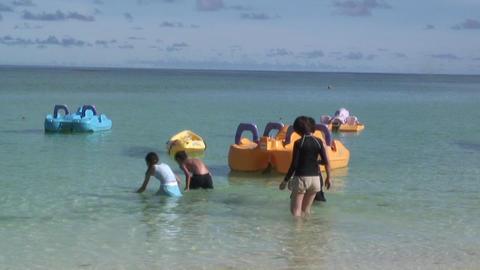 SeaAndBoatInGuam01 mov 1 Stock Video Footage