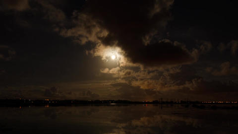 Moon rising reflection on a lake Stock Video Footage