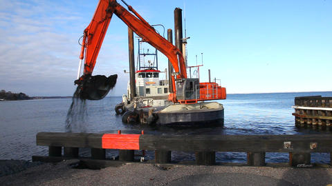 Excavator at sea Stock Video Footage