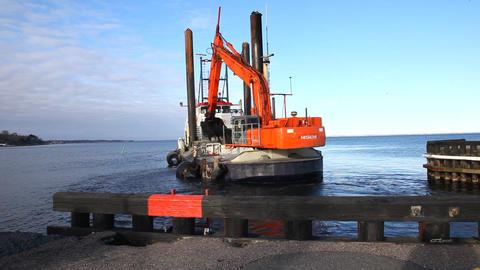 Excavator at sea Stock Video Footage