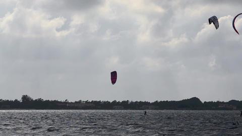 Kitesurfers in action Stock Video Footage