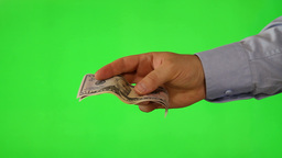 Hand offering money on green screen Footage