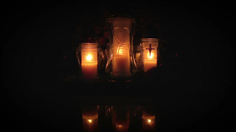 Candles burning in mourning near waters edge Archivo