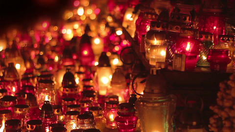 Hundreds of candles glowing in cemetery at night Footage