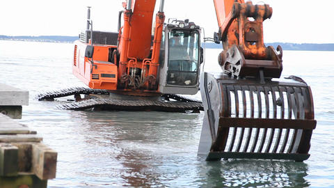 A working excavator Stock Video Footage