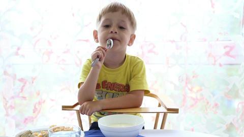 The little boy eats Live Action
