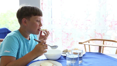 The boy eats porridge Footage