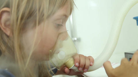 The girl is treated, making inhalation, uses the inhaler Live Action