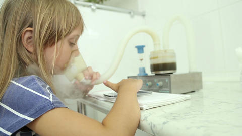 The girl is treated, making inhalation, uses the inhaler Footage