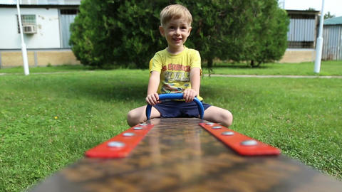 Little boy riding seesaw Footage