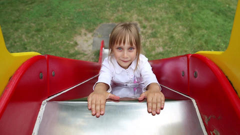 Girl riding on a sliding board Live Action