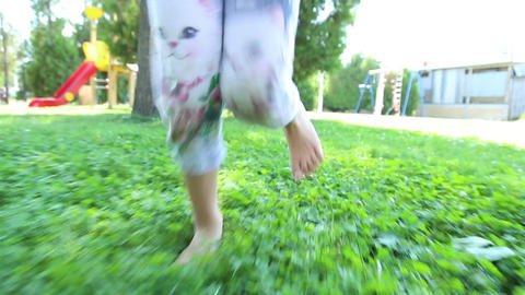 Girl and boy running barefoot on the grass Live Action