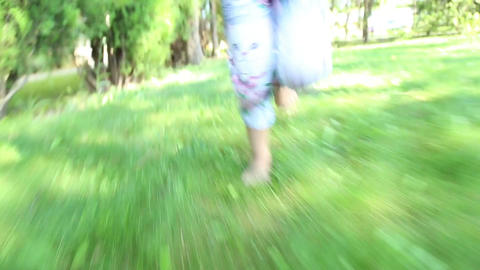 Girl running barefoot on the grass Live Action