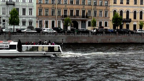 St. Petersburg, Russia - June 12, 2015: Excursion boat floats on the river. June Footage