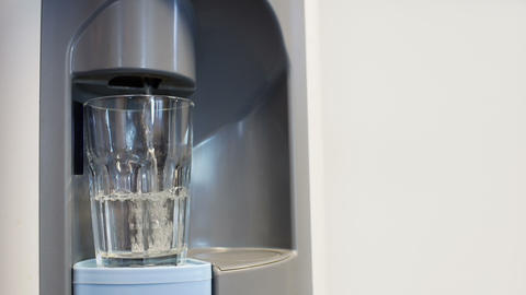 Filling big glass in water dispenser Footage