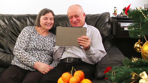 Seniors Couple Using Tablet Computer Talking With Video Chat stock footage
