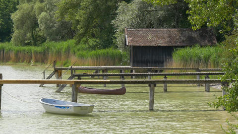 Traditional boathouse at lake Ammersee near Munich, Bavaria, Germany Footage