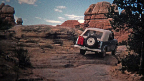 1971: Jeep driver bouldering up a steep incline offroad trail Footage