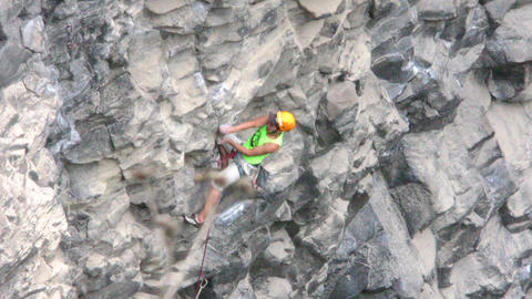 Seasoned Rock Climber Advancing Rapidly On Basalt Rock Stock Video Footage