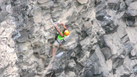 Seasoned Rock Climber Advancing Rapidly On Basalt Rock Footage