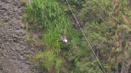 Adult man sliding at high speed on zip line Footage
