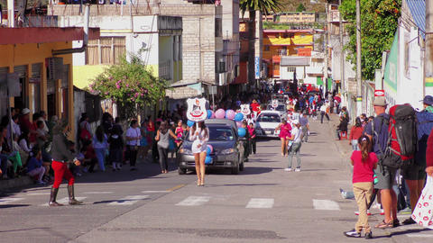 Public performance of Sagrado Corazon students on the streets of Banos De Agua S Footage